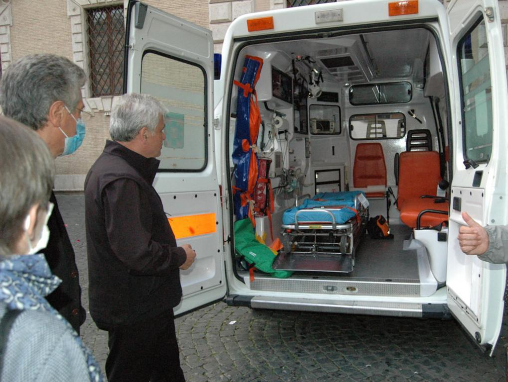 The Ambulance for the poor, gift of Pope Francis, stops at Santa Maria in Trastevere